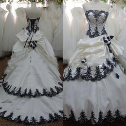 White Gothic Corset Wedding Dresses NZ - Stunning Black and White Ivory Champagne Wedding Dresses Strapless Lace Appliques Beading Corset Gothic Bridal Gowns with Handmade Flowers