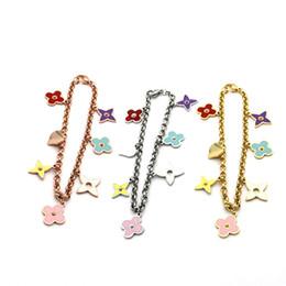 Comércio por grosso de titânio pulseira de aço cor quente óleo quatrefoil pulseira multi acessórios 18k pulseira de ouro feminino Ms. venda por atacado