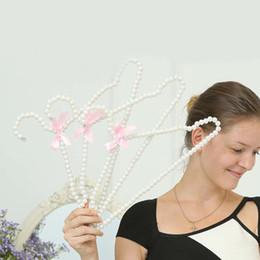 $enCountryForm.capitalKeyWord Canada - High-grade Pearl Hanger with bow for Wedding Dress Lady Clothes Anti-slip Non-trace Clothing Shop Window Display Rack 40cm