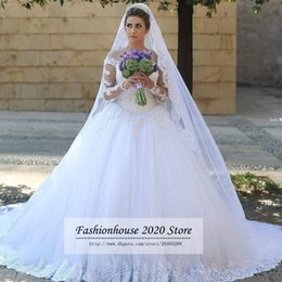 Lace Wedding Dresses Canada - Arabic Style Lace Long Sleeve Wedding Dresses Sheer Illusion Tulle Neck Beaded Applique Long Train Wedding Bridal Gowns Bride Dresses