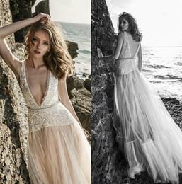 Bohemian Wedding Dresses Crystal Canada - 2018 New Beach Wedding Dresses Sexy Deep V Neck Backless Netta BenShabu Wedding Dress Crystal Beaded Bohemian Bridal Gowns