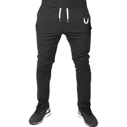 China New Fashion Men's Casual Pants Top Quality Brand Clothing 2018 Muscle Type Flying V-wing Logo Sports Fitness Running Cotton Trousers S-XXL cheap new types pants suppliers