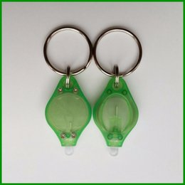 $enCountryForm.capitalKeyWord NZ - Wholesale promotional gifts customized Green color of body mini led Strong UV Light key chain with metal keyring expoxy sticker of logo