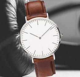 14bbe4eaa New Men Women Business Wristwatch Leather Strap Gold Silver Quartz Watch  Ultra thin Shell Geneva Creative Casual Clock watch