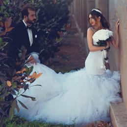 Gold White Puffy Wedding Dress NZ - Gorgeous White Lace Mermaid Wedding Dresses Spaghetti Straps Sexy Open Backless Bridal Dress 2017 Stunning Puffy Ruffles Train Wedding Gowns