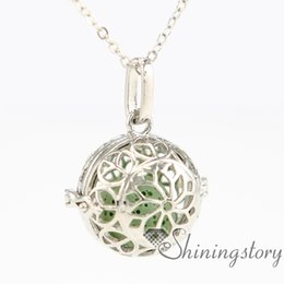 Chinese  peace sign flower ball metal volcanic stone heart locket essential oil diffuser jewelry kids locket wholesale aromatherapy jewelry openwork manufacturers