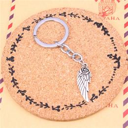 $enCountryForm.capitalKeyWord Canada - Car Key Ring Pendant Silver Color Metal Key Chains Accessory Wholesale Free Shipping,Vintage angel wings flower Keychain