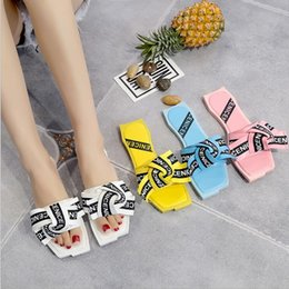 Decorating Flats NZ - 2017 summer new fashion slippers shoes flat down the word drag the bow decorated female slippers beach shoes