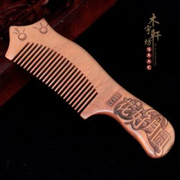 health hair care Canada - Manufacturers wholesale boutique thickening old mahogany carved combs Health care massage anti-static wooden comb hair comb