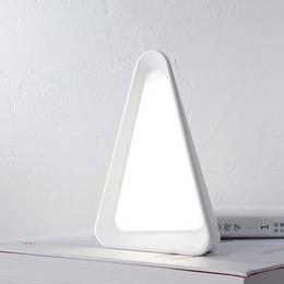 $enCountryForm.capitalKeyWord Canada - Creative flip light adjustable light eye protection small desk lamp USB charging touch table lamp triangle shape