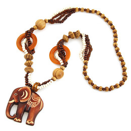 bohemian sweaters women Canada - Bohemia Folk-custom Fashion Costume Accessories Jewelry Vintage Retro wood Bead Circle Carved Elephant Pendants Sweater Necklaces For Women