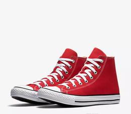 Envío de la gota A estrenar 15 colores Todos los tamaños 35-46 High Top Low Top Clásico Zapatillas de lona Zapatillas de deporte de los hombres de las mujeres Zapatos ocasionales