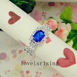 Blue Napkin Holders NZ - Wholesale- 12pcs lot Royal Blue color Wedding Banquet Dinner Decor Silver Hoops White Diamante Napkin Ring Serviette Holder