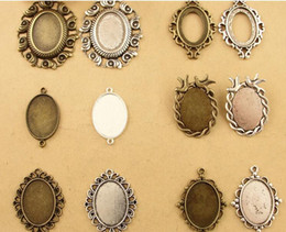 China Fit 25*18MM DIY accessories wholesale oval metal stamping blank, antique cameo cabochon setting, tibetan silver bird pendant base bezel tray suppliers