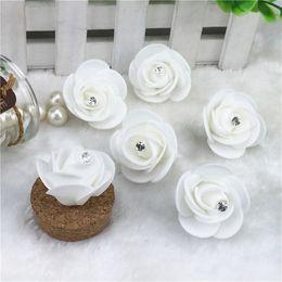 $enCountryForm.capitalKeyWord Canada - Cheap 50pcs Mini PE Foam Artificial Rose Flowers For Wedding Car Decoration DIY Wreath Decorative Valentine's day Fake Flowers