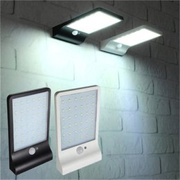 Discount patio walls - PIR Motion Sensor LED Wall lamp Solar Power Outdoor Night light For Street Garden Door Path Yard Path Fence Patio Securi