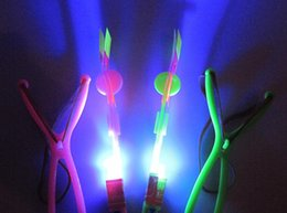 Toy Swords Wholesale Canada - Arrows flying rubber band luminous wholesale small stretch Arrows Arrows flying umbrella emitting toys wholesale children's sword