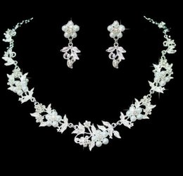 Alloy Jacket Canada - New alloy bridal jacket tree leaves pearl necklace earrings fashion Korean wedding dress two sets of flowers rhinestones necklace