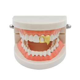 fake teeth halloween NZ - Fake Teeth Fangs Hollow Gold Plated Hip-hop Single Tooth Grillz Cap Hiphop Vampire Props Body Jewelry Silicone Halloween Party Gifts