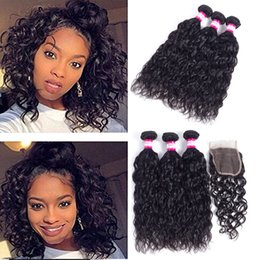 Chinese  Fast Shipping Brazilian Water Wave Human Hair with Lace Closure in Natural Color 10A Unprocessed Brazilian Remy Virgin Hair Bundles Closures manufacturers
