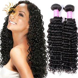 Peruvian Deep Curly Wavy Hair Canada - 6A Mink Brazilian Virgin Hair Curly 4 Bundles Deep Wave Brazilian Hair Weave Bundles Wet And Wavy Human Hair Extensions Brazilian Deep Curly