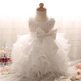 Vente en gros Mode Bébé Fille Robe Dentelle Fleur Blanche Filles Robes Super Arc Princesse Enfants De Mariage Pageant Robe De Soirée Infant D'été Tissu