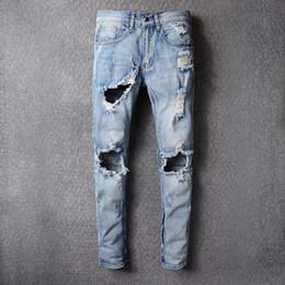 Men s juMpsuits online shopping - KANYE Justin Bieber Men Jeans Ripped Jeans Fashion Designer Blue Rock Star Mens Jumpsuit Designer Denim Male Pants