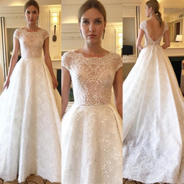 Bling Bling Lace Wedding Dresses Capped Sleeves Sheer Vestido De Novia Sexy  Backless Sequined Wedding Gowns 18485d4ac312