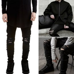 6996cb4451a97 Wholesale-2016 ripped jeans for men skinny Distressed slim famous brand  designer biker hip hop swag tyga white black jeans kanye west