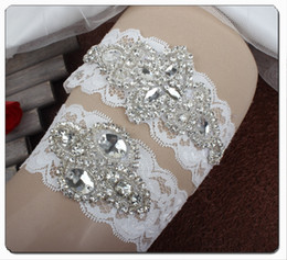 Venta al por mayor de Cuentas de cristal de lujo Arco 2 unids Conjunto Liga de novia de encaje blanco Lujas para la boda de la novia Lujas de la pierna al por mayor de la novia.