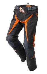 2016 KTM nuevo modelo OEM carrera a campo traviesa Pantalones / pantalones / pantalones / motocicleta protectora pantalones de carreras de color negro M L XL Envío gratis en venta