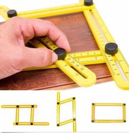 линейка набор ручного инструмента Практические четыре Складные пластиковые Метрическая шкала Многофункциональный Измерительные инструменты Лучшие продажи мульти угол линейка на Распродаже