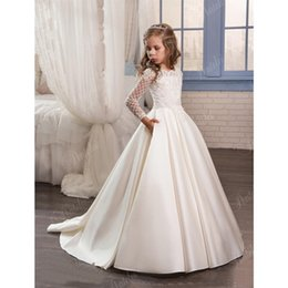 China 2019 New Dresses for Little Girls Pentelei Cheap with Long Sleeves and Pockets Appliques Satin Ivory Party Flower Girl Dresses suppliers