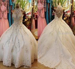 Castle Bling Wedding Dress Canada - 2017 Luxury Ball Gown Wedding Dresses High Neck Bling Shining Crystal Appliqued Organza Chapel Train Plus Size Backless Wedding Gowns