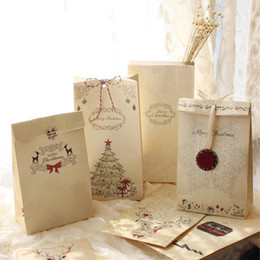 Barato Bolsas De Papel Favor A Atacado-Atacado- Novo 6pcs / set Kraft Paper Bag Merry Christmas Gift Bags Partido Lolly Favor Bowknot Casamento Embalagem 22x12x6cm Mix