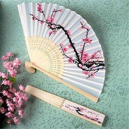 $enCountryForm.capitalKeyWord Canada - Free Shipping 50pcs Unique Chinese Folding Hand Fan Cherry Blossom Bamboo Silk Fan Wedding Favors Costume Decor