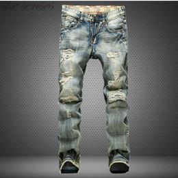 Mens Famous Brand Jean Canada - Wholesale-Big Size 42 European Style Men Jeans Famous Brand Holes Frazzle Jeans Mens Casual Leisure Denim Long Pants Light Blue SL0293
