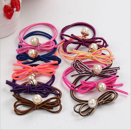 Korea Child Hair Canada - South Korea candy colored Bow Ring pearl pendant elastic hair rope Tousheng children ring jewelry wholesale random delivery
