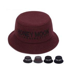 China Autumn Winter Men Women Wool Fisherman's Hat Fashion Felt Trilby Hat Cap 5 Colors Letter Portable Bucket Hats for Unisex GH-258 suppliers
