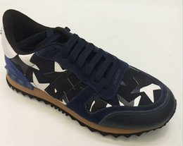 China Size 35-46 Women Men casual shoes camouflage genuine leather lace up couple star shoes unisex rivets flat shoes cheap star flat button suppliers