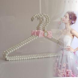 $enCountryForm.capitalKeyWord Canada - Luxury 40cm Pearl Hangers With Bow for Lady Women Wedding Dress Coat High Grade Racks Clothes Storage Hanger