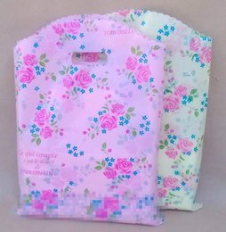 boutique clothes Canada - 100pcs lot 25x35cm Rose Flower Boutique Bags Packaging Bag Shopping Clothes Bag Weeding Gift Candy Bags thick bags