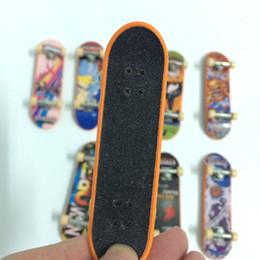 Finger Skateboard Mini Canada - Wholesale-Quality Alloy FingerBoard mini finger boards funny finger skateboard toys mini skateboard toy for children