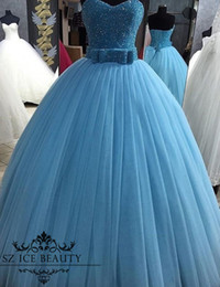 Sexy Light Up Shirts Canada - Major Beaded Puffy Sweet 16 Dresses 2017 Plus Size Pleat Ball Gown Quinceanera Dress Bow Belt Sky Blue Tulle Lace Up Prom Gowns