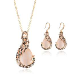 crystals rhinestones wholesale Australia - Vintage Rhinestone Bridal Jewelry New Fashion rose Gold Opal Crystal Peacock Necklace Earrings Wedding jewellery Set for women