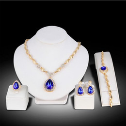 $enCountryForm.capitalKeyWord NZ - Fashion Earring Ring Bracelet Necklace Sets KC Gold Alloy Leaf Chain Blue Stones Rhinestone Pendant Necklace Women Party Jewelry Set