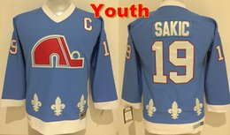 ... AUTHENTIC CCM ULTRAFIL ON ICE WHITE JERSEY 48 Youth Throwback Quebec  Nordiques Jerseys 19 Joe Sakic Jersey Kids Baby Blue New Vintage CCM Boys . 20bc6cde1