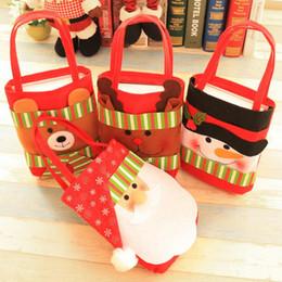 Discount snowman decorations - 42*21cm Nonwovens Christmas Candy Bags Christmas Decoration Cartoon Santa Claus Snowman Bags Creative Festivel party Sup
