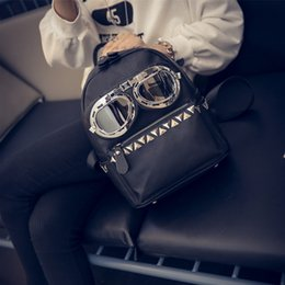 $enCountryForm.capitalKeyWord Canada - Wholesale- Girl's Fashion Backpacks Punk Street Style PU Leather Bags Rivet Glasses Decoration Backpacks For Women Travel Bags