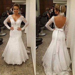 Barato Backless Vestidos De Mangas Compridas-Vintage Lace Country Wedding Dress Deep V Neck Sexy Backless Ilusão Long Sleeved Mermaid Vestidos de noiva Trompete Vestidos de noiva com faixa